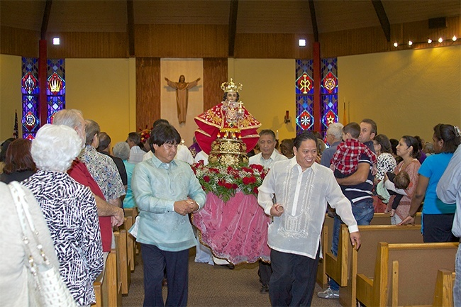 people processing carrying the santo nino de cebu